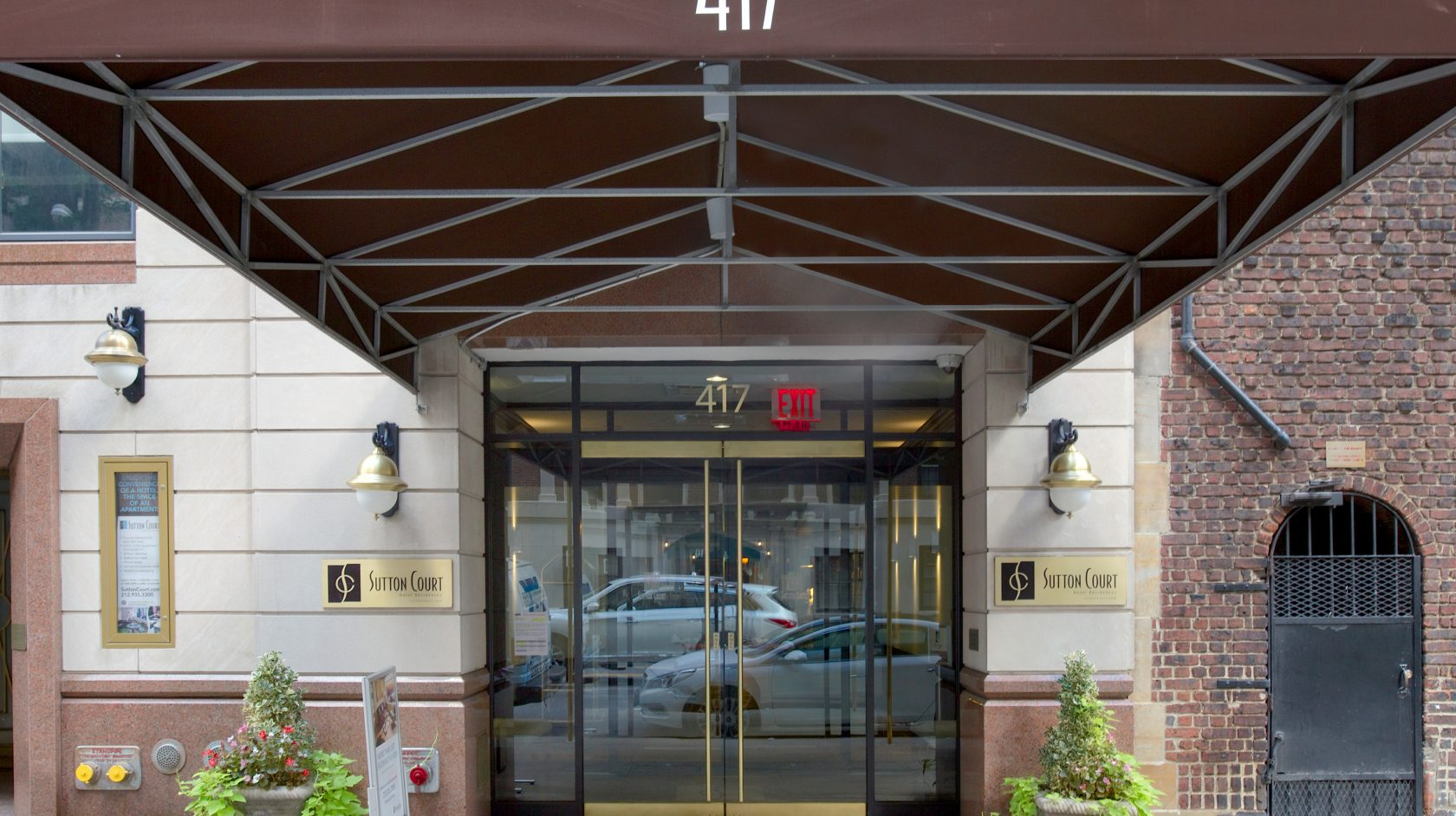 front view of entrance of Sutton Court Hotel in NYC